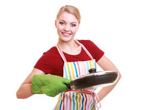 Happy housewife or chef in kitchen apron with skillet frying pan Royalty Free Stock Photo