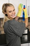 Happy Housewife Cleaning Kitchen stock photo