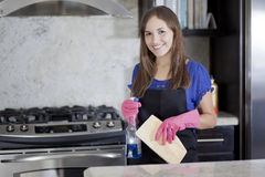 Happy housewife cleaning the kitchen Stock Photo