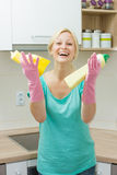 Happy housewife cleaning in the kitchen Stock Photography