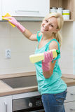 Happy housewife cleaning in the kitchen Royalty Free Stock Photos