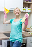 Happy housewife cleaning in the kitchen Royalty Free Stock Photography
