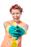 Happy housewife with cleaning spray Stock Photo