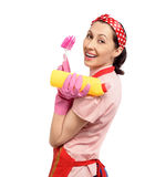 Happy housewife with cleaning supplies Stock Image