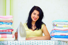 Happy housewife completed ironing, home interior Stock Photo