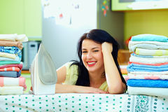 Happy housewife completed ironing, home interior Stock Image