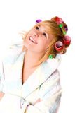 Happy housewife with curlers Stock Photos