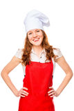 Happy housewife dressed as a cook Stock Photos