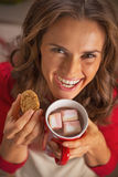 Happy housewife drinking chocolate and eating christmas cookie Stock Image