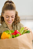 Happy housewife examines purchases after shopping Stock Image