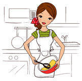 Happy housewife holding a bowl and whisk Royalty Free Stock Photography