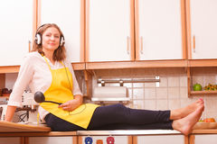 Happy housewife at home Royalty Free Stock Photo