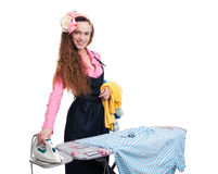 Happy housewife ironing Royalty Free Stock Images