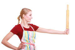 Happy housewife kitchen apron holds rolling pin isolated Royalty Free Stock Photos