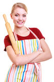 Happy housewife kitchen apron holds rolling pin isolated Royalty Free Stock Photography