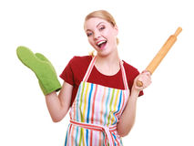 Happy housewife kitchen apron oven mitten holds rolling pin isolated Royalty Free Stock Images