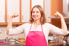 Happy housewife in kitchen Royalty Free Stock Images