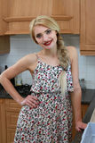 Happy Housewife in kitchen Royalty Free Stock Photography