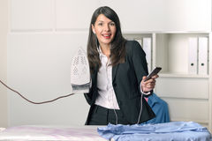 Happy housewife listening to music while ironing Royalty Free Stock Photo