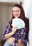 Happy housewife with many euro Royalty Free Stock Photos