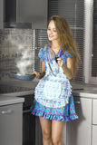 Happy housewife in modern kitchen Stock Photo
