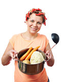 Happy housewife with pan vegetables Royalty Free Stock Photos