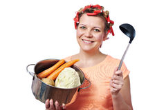 Happy housewife with pan vegetables Stock Image