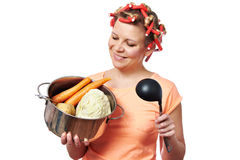Happy housewife with pan vegetables Royalty Free Stock Image