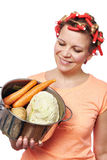 Happy housewife with pan vegetables Stock Photos