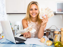Happy housewife planning budget Stock Photo