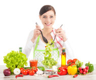 Happy housewife preparing salad. Royalty Free Stock Photography