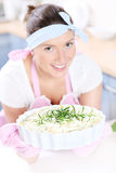 Happy housewife with quiche Royalty Free Stock Photo