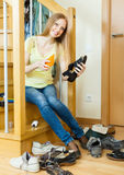 Happy  housewife with shoes Stock Photo