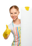 Happy housewife with thumbs up with white empty billboard isola. Ted on white background royalty free stock images