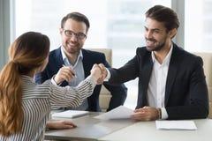 Happy hr manager shaking hand female job seeker. stock photo