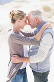 Happy hugging couple on the beach looking at each other Royalty Free Stock Photography