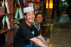 Happy Hui shoe seller Royalty Free Stock Image