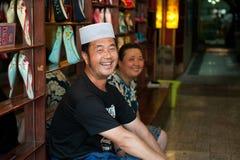 Happy Hui shoe seller Royalty Free Stock Image