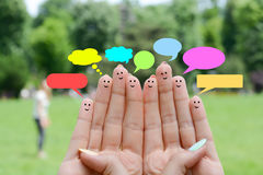 Happy human fingers suggesting feedback and communication concept. Happy human fingers with thought bubbles suggesting feedback and communication concept Royalty Free Stock Image
