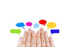 Happy human fingers suggesting feedback and communication concept. Happy human fingers with thought bubbles suggesting feedback and communication concept Stock Photography