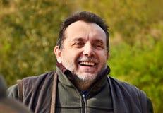 Happy hunter. Cheerful and amused gray bearded hunter Royalty Free Stock Photos