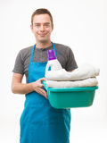 Happy husband doing laundry Stock Images