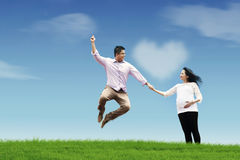 Happy husband with his pregnant wife. Holding hands on the field Royalty Free Stock Photos