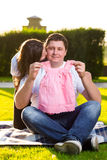 Happy husband with pregnant wife playing in nature Stock Photography