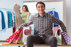 The happy husband shopping with his wife Stock Photo