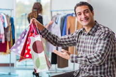 The happy husband shopping with his wife Stock Image