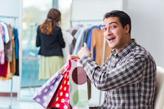 The happy husband shopping with his wife Royalty Free Stock Image