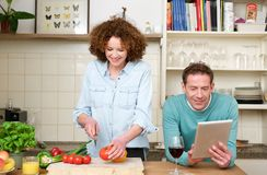 Happy husband and wife cooking in the kitchen Royalty Free Stock Photos