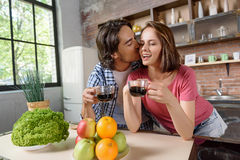 Happy husband and wife enjoying drink at home Royalty Free Stock Photography