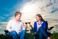 Happy husband and wife with glasses  at sunset Stock Image
